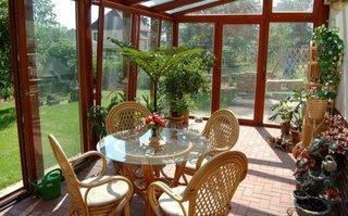 Veranda inchisa cu profile PVC si geam termopan